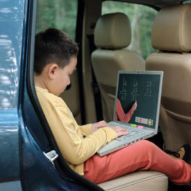 boy with laptop in car.jpg